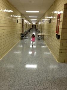 Little girl in a big school
