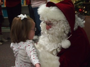 This was the Santa at Ryan's school.  He was so sweet with her and told her he loved her.